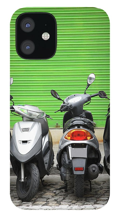 Macao iPhone 12 Case featuring the photograph Line Of Motorbikes Against Green by Steven Puetzer