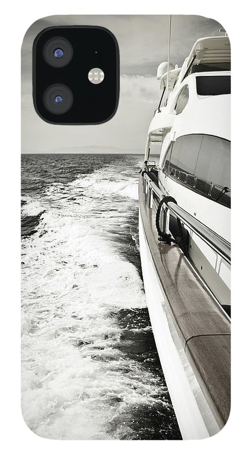 Desaturated IPhone 12 Case featuring the photograph Luxury Yacht Sailing At High Speed In by Petreplesea