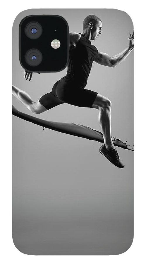 People IPhone 12 Case featuring the photograph Male Athlete Running Above Liquid Splash by Jonathan Knowles