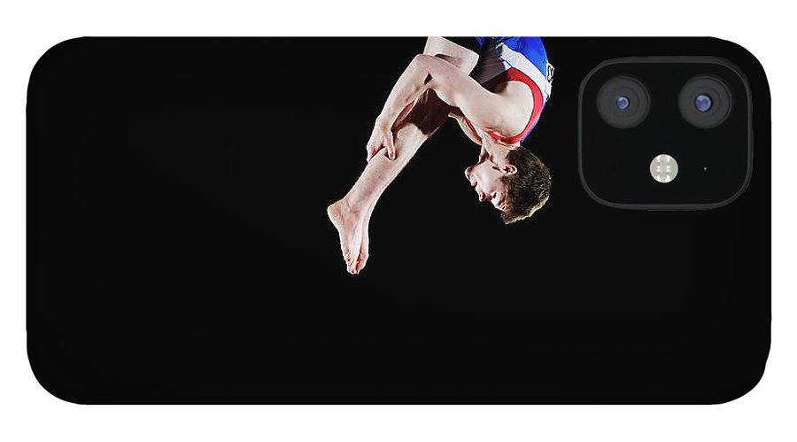 Focus IPhone 12 Case featuring the photograph Male Gymnast 16-17 Mid Air, Black by Thomas Barwick