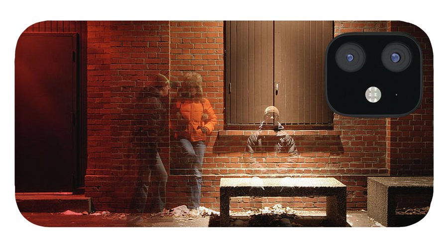 Mature Adult IPhone 12 Case featuring the photograph Man And Woman Leaning Against A Brick by Lori Andrews