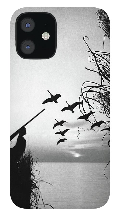 Rifle IPhone 12 Case featuring the photograph Man Duck-hunting by Stockbyte