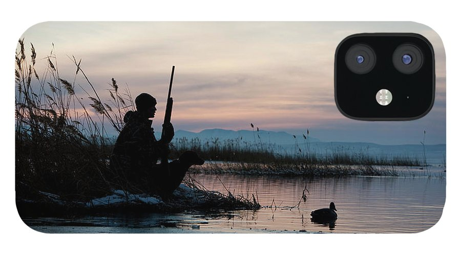 Rifle IPhone 12 Case featuring the photograph Man Out Hunting by Rubberball Productions