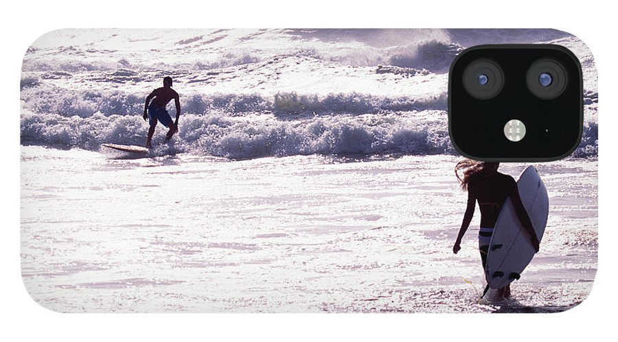 Wind IPhone 12 Case featuring the photograph Man Surfing On Sea, Woman Walking With by Johner Images