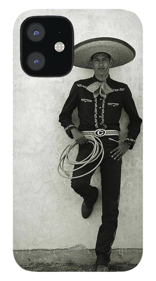 Cool Attitude IPhone 12 Case featuring the photograph Mexican Cowboy Wearing Hat And Holding by Terry Vine
