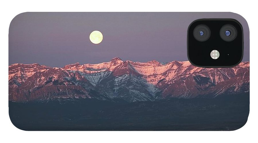 Front Range iPhone 12 Case featuring the photograph Moon Set Over Front Range Mountains by Design Pics / Michael Interisano