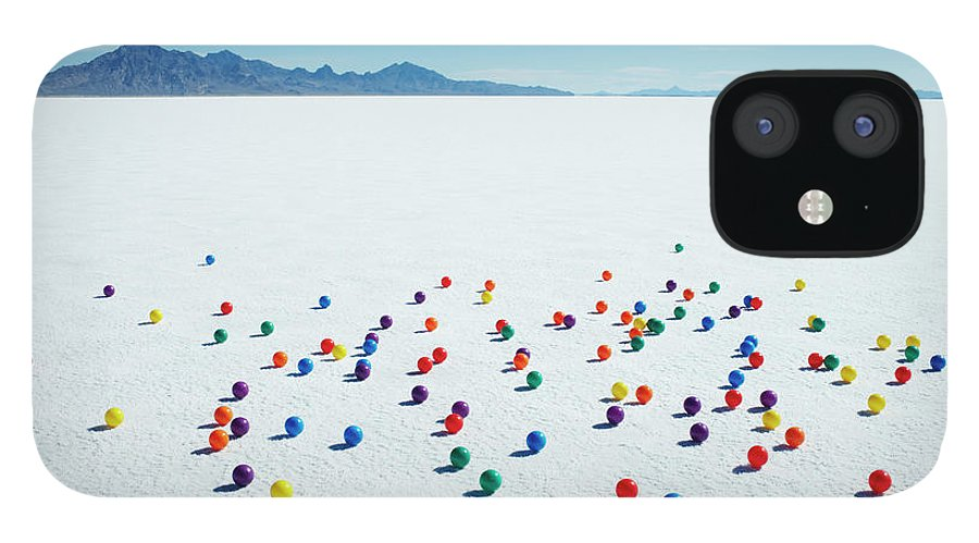 Out Of Context IPhone 12 Case featuring the photograph Multi-colored Balls On Salt Flats by Andy Ryan