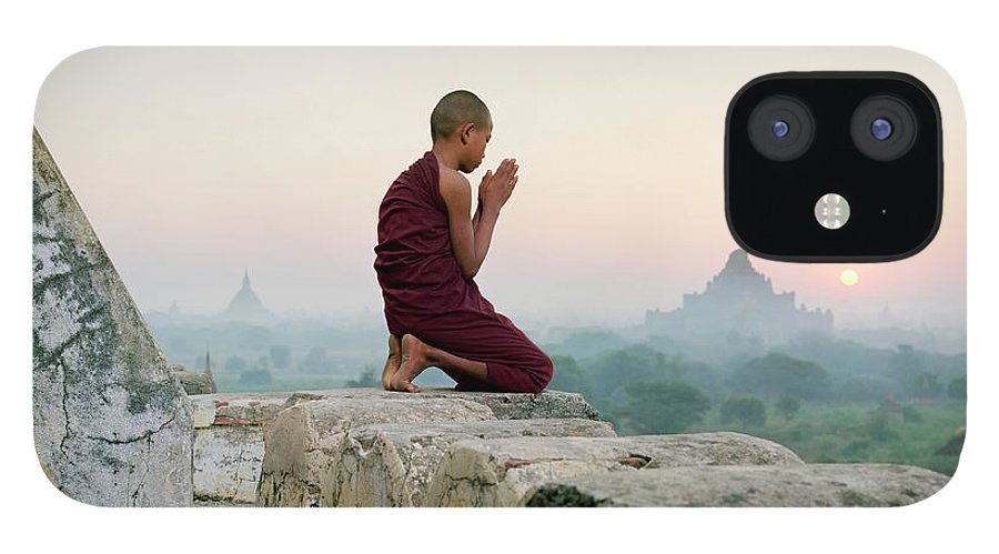 Child IPhone 12 Case featuring the photograph Myanmar, Bagan, Buddhist Monk Praying by Martin Puddy