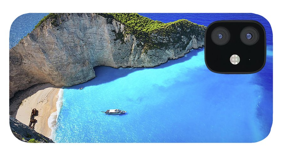 Extreme Terrain IPhone 12 Case featuring the photograph Navagio Beach, Zakynthos Island, Greece by Rusm