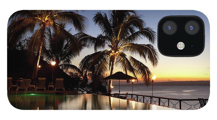 Swimming Pool IPhone 12 Case featuring the photograph Nightfall At Iririki Island, Vanuatu by Holgs