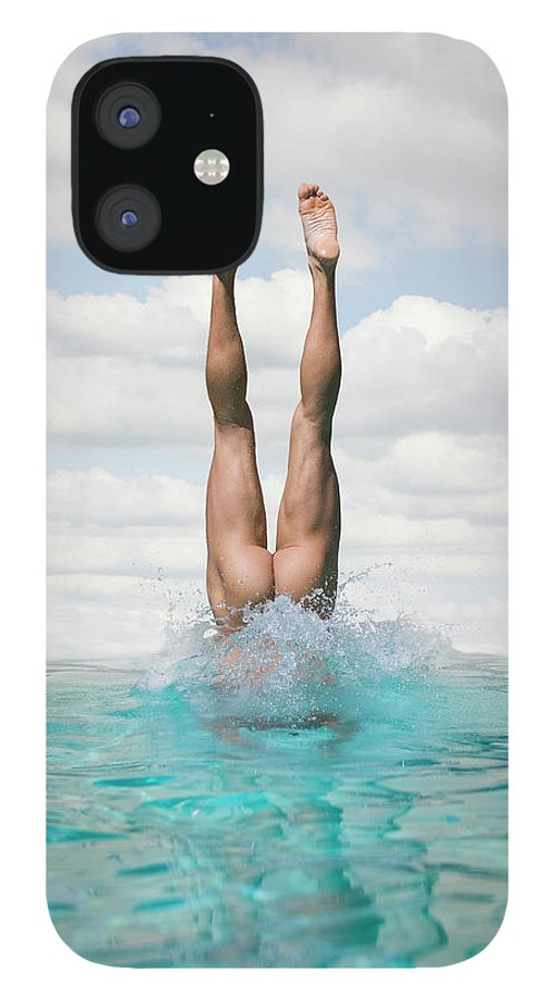 Diving Into Water IPhone 12 Case featuring the photograph Nude Man Diving by Ed Freeman