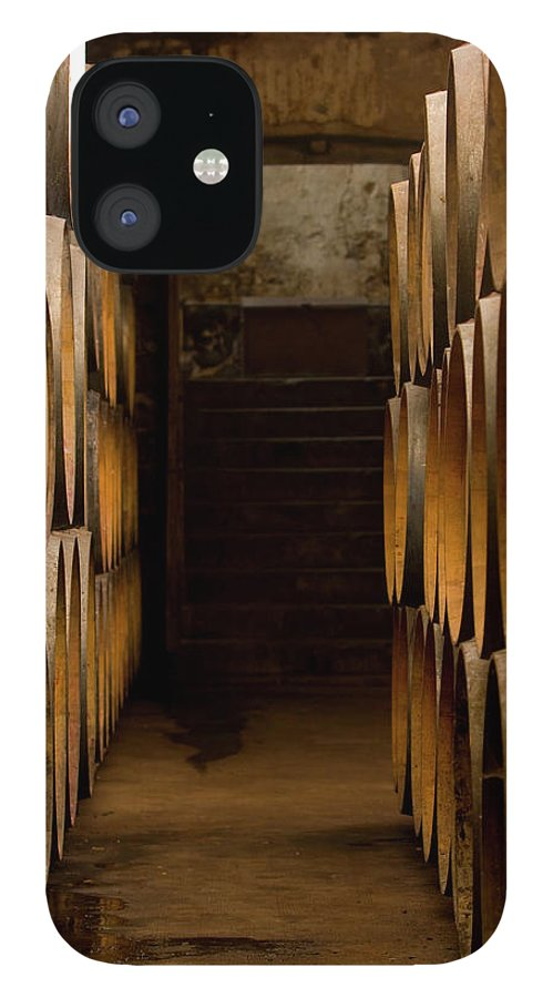 Alcohol IPhone 12 Case featuring the photograph Oak Barrels At The Wine Cellar by Kycstudio
