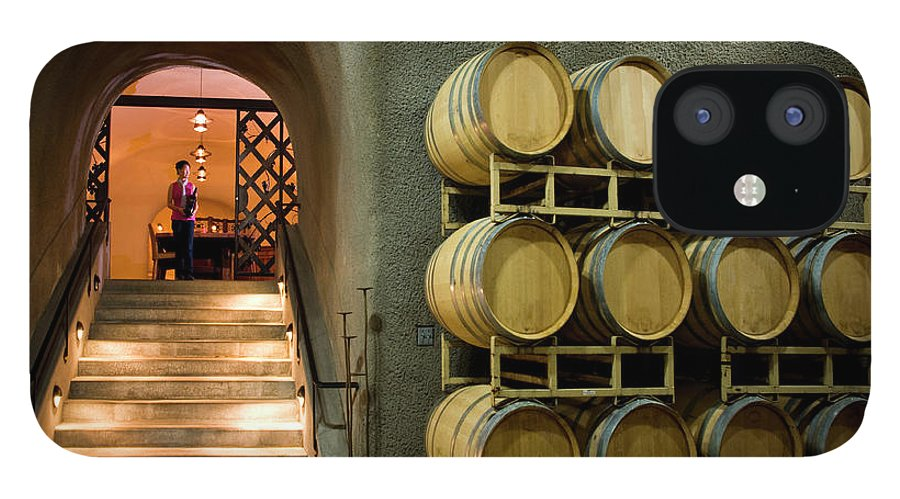 Sonoma County IPhone 12 Case featuring the photograph Oak Barrels In Wine Cave At Winery Napa by Seanfboggs