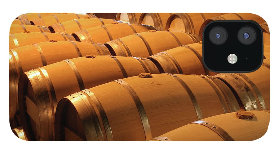 Fermenting IPhone 12 Case featuring the photograph Oak Wine Barrel Rows In Winery Cellar by Yinyang