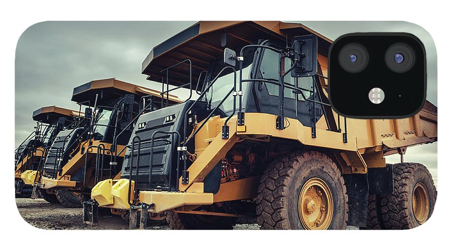 Construction Machinery IPhone 12 Case featuring the photograph Off-highway Dump Trucks by Shaunl