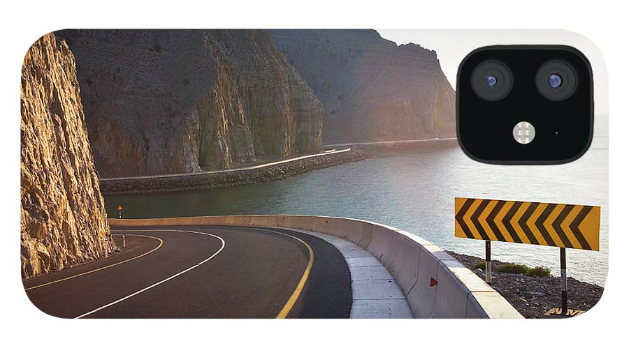Curve iPhone 12 Case featuring the photograph Oman, Khasab, Road Round Mountain By by Christian Adams