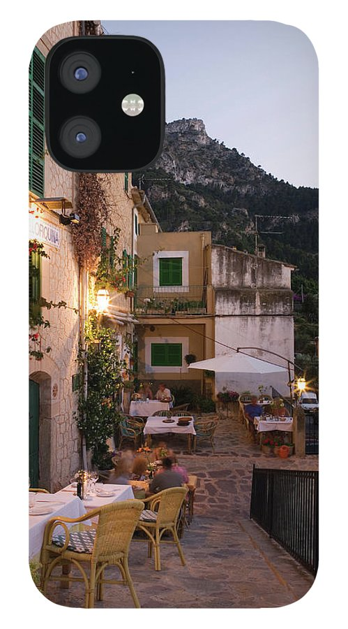 People IPhone 12 Case featuring the photograph Outdoor Seating At Son Llarg Restaurant by Holger Leue