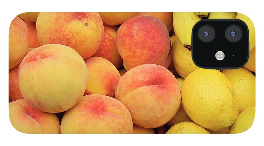 Retail IPhone 12 Case featuring the photograph Peaches, Lemons And Bananas At Farmers by Travelif