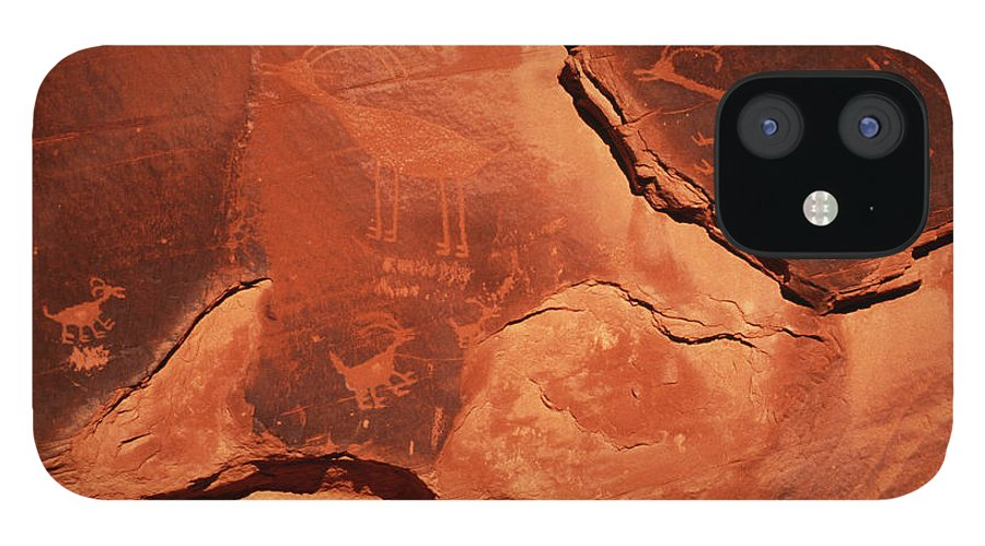 Arizona IPhone 12 Case featuring the photograph Petroglyphs, Monument Valley, Arizona by Gannet77