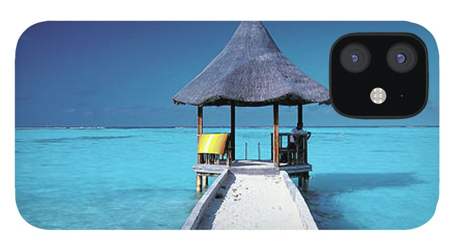 Tranquility iPhone 12 Case featuring the photograph Pier And Blue Indian Ocean, Maldives by Peter Adams