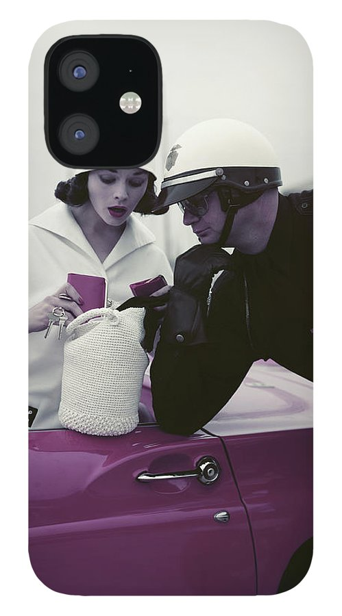 Headwear IPhone 12 Case featuring the photograph Police Officer Examining License Of by Tom Kelley Archive