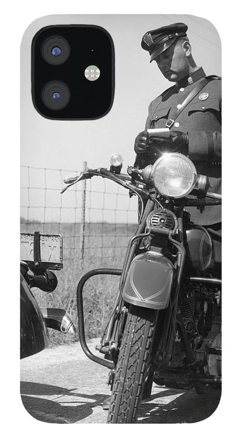 People IPhone 12 Case featuring the photograph Policeman On A Motorcycle Writing A by H. Armstrong Roberts