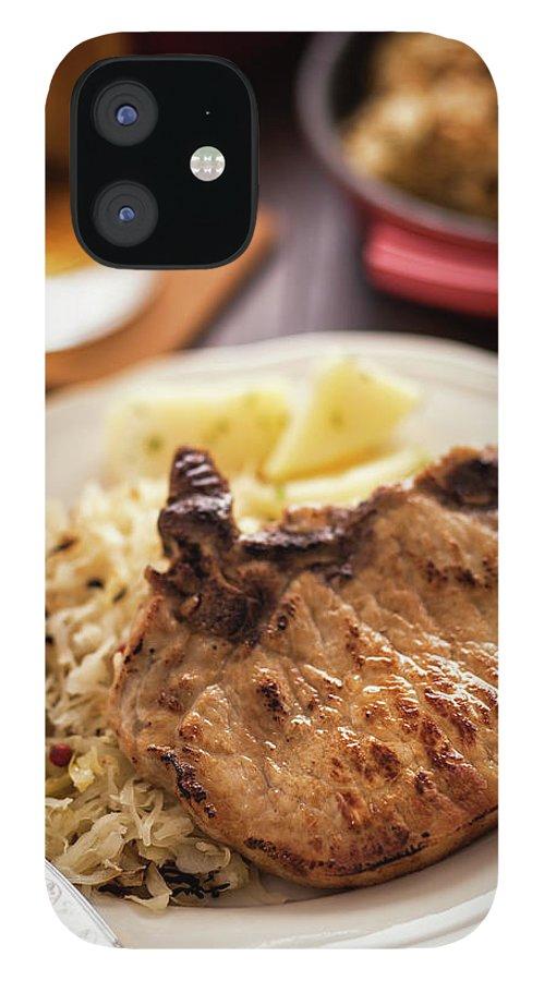 Meat Chop IPhone 12 Case featuring the photograph Pork Chop And Sauerkraut by Gmvozd