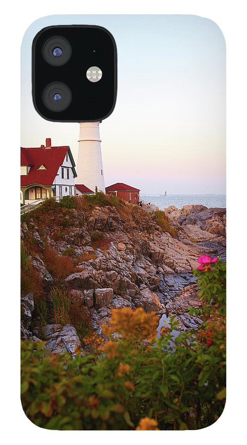 Clear Sky iPhone 12 Case featuring the photograph Portland Head Lighthouse At Susnet by Thomas Northcut
