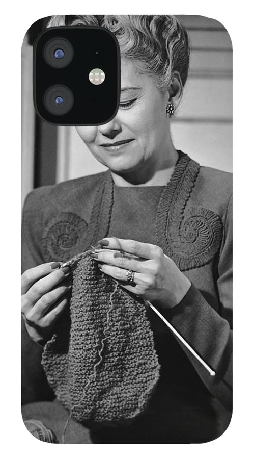 Mature Adult IPhone 12 Case featuring the photograph Portrait Of Mature Woman Crocheting by George Marks