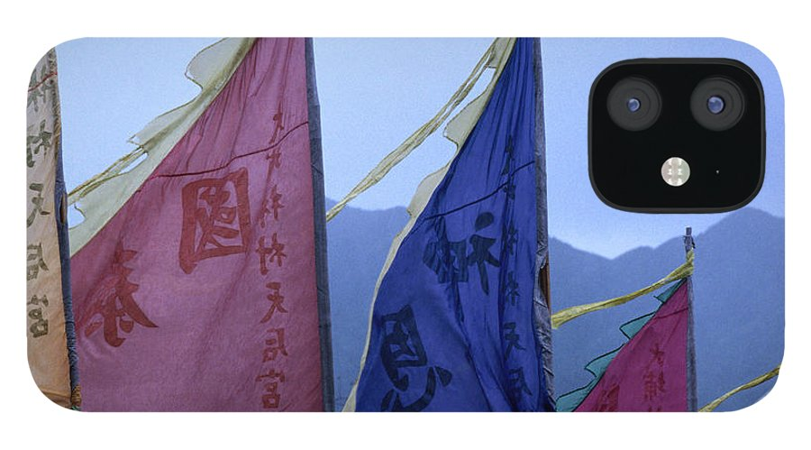 Chinese Culture IPhone 12 Case featuring the photograph Prayer Flags To The Sea Goddess Blow In by Lonely Planet