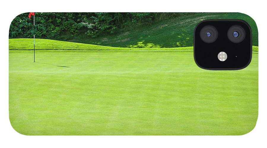The End IPhone 12 Case featuring the photograph Putting Green And Flag At A Golf Course by Stuart Dee