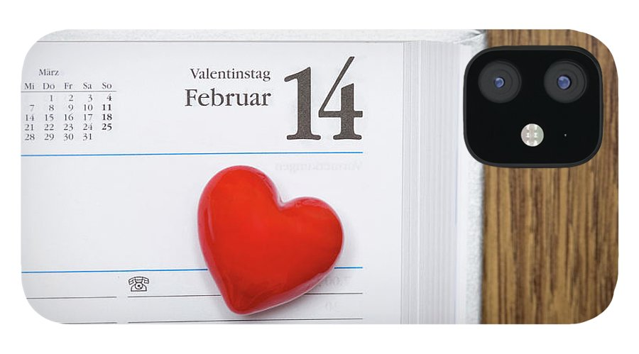 Celebration IPhone 12 Case featuring the photograph Red Heart Marking Valentines Day In A by Stock4b-rf