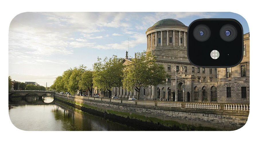 Dublin IPhone 12 Case featuring the photograph River Liffey And The Four Courts In by Lleerogers
