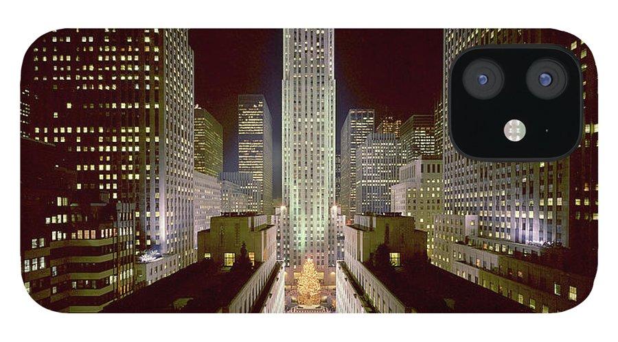 1980-1989 IPhone 12 Case featuring the photograph Rockefeller Center, Manhatten, At by Thorney Lieberman