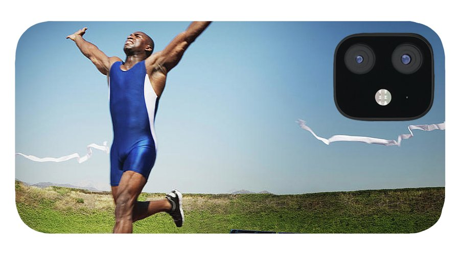 Human Arm IPhone 12 Case featuring the photograph Runner Crossing Finish Line by Jupiterimages