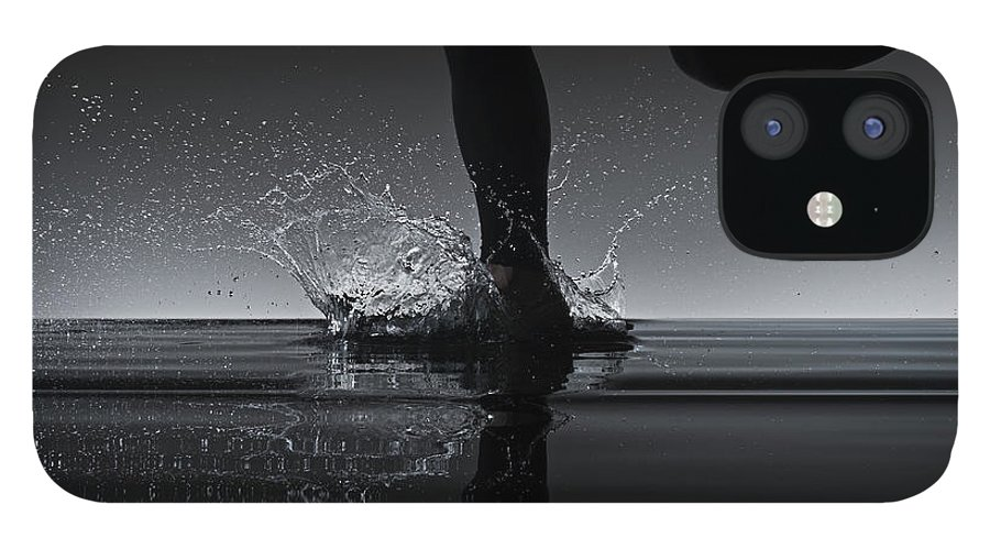 Recreational Pursuit IPhone 12 Case featuring the photograph Running Through Water by Jonathan Knowles