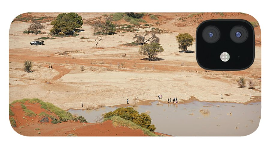 Namibia IPhone 12 Case featuring the photograph Safari Tourists By Sossusvlei Pan by Bjarte Rettedal