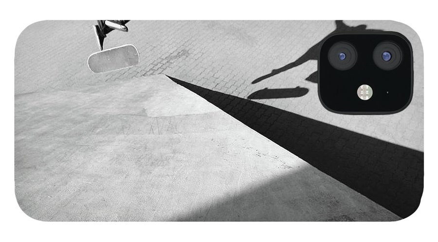 Shadow IPhone 12 Case featuring the photograph Shadow Of Skateboarder by Mgs