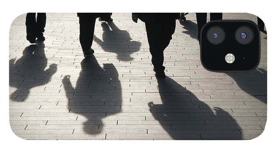 Shadow IPhone 12 Case featuring the photograph Shadow Team Of Commuters Walking On by Peskymonkey