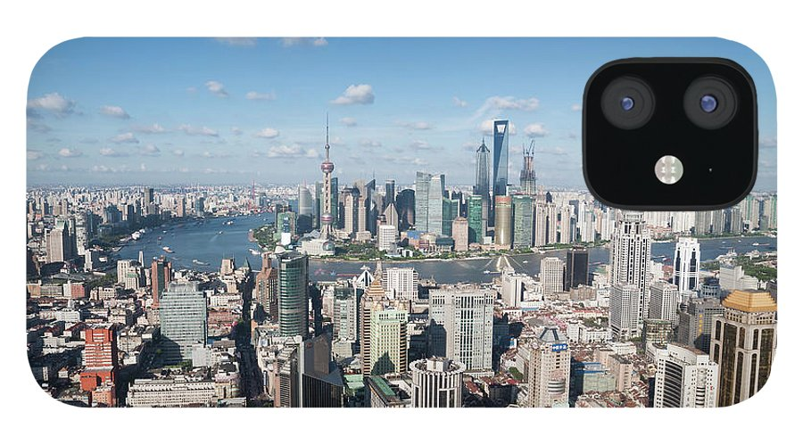 Tranquility iPhone 12 Case featuring the photograph Shanghai Skyline Across The Huangpu by Hugociss