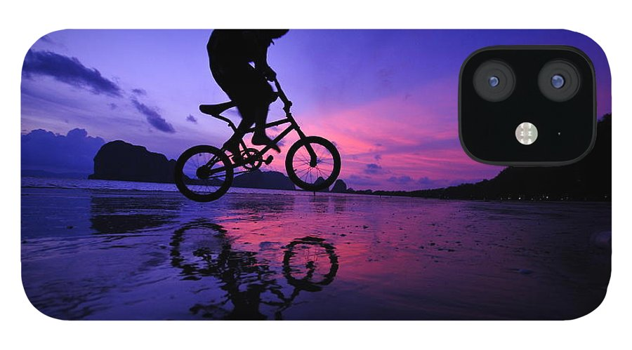The Twilight Series IPhone 12 Case featuring the photograph Silhouette Of A Mountain Biker On Beach by Primeimages