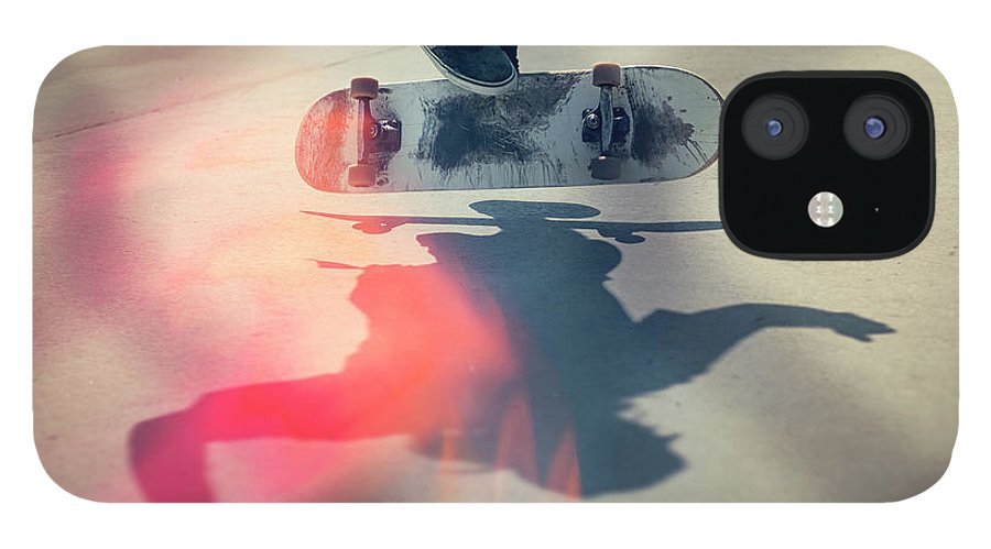 Cool Attitude IPhone 12 Case featuring the photograph Skateboarder Doing An Ollie by Devon Strong