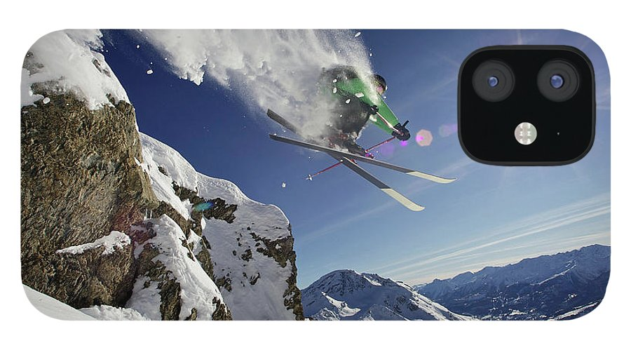 Young Men IPhone 12 Case featuring the photograph Skier In Midair On Snowy Mountain by Michael Truelove