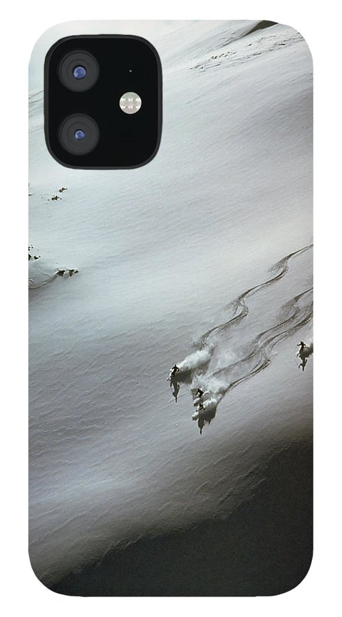 Shadow IPhone 12 Case featuring the photograph Skier Moving Down In Snow On Slope by John P Kelly