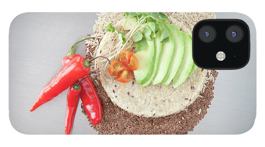 Flax Seed IPhone 12 Case featuring the photograph Sliced Avocado And Peppers With Grains by Laurie Castelli