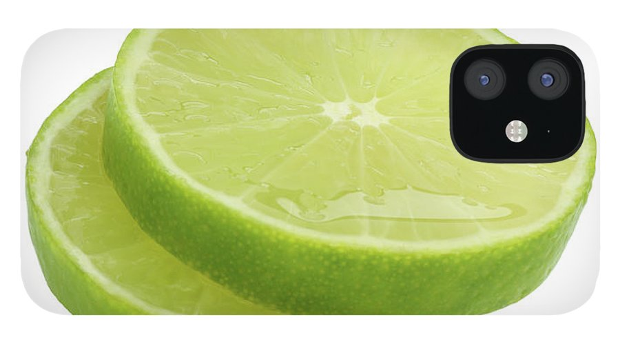 White Background IPhone 12 Case featuring the photograph Slices Of Fresh, Juicy, Freshly Cut Lime by Rosemary Calvert