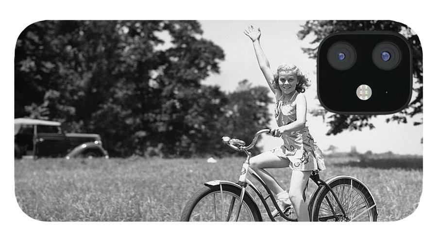 Bicycle Seat IPhone 12 Case featuring the photograph Smiling Girl Wearing A Jumper Short Set by H. Armstrong Roberts