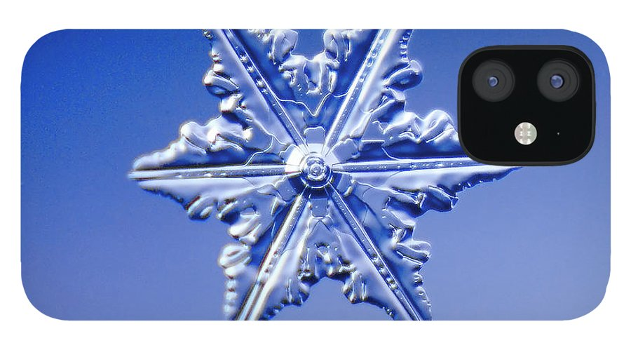 Snow IPhone 12 Case featuring the photograph Snowflake On Blue Background by Fwwidall