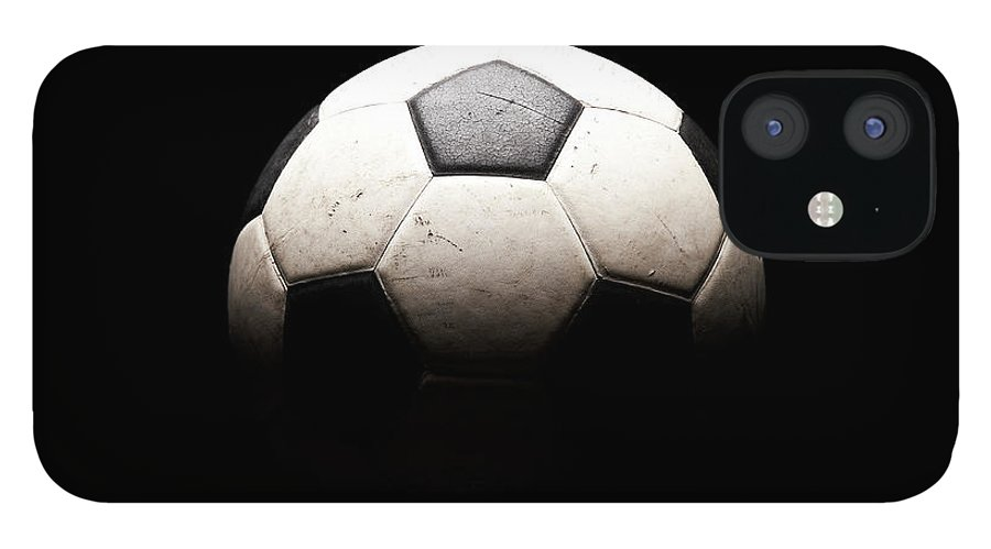 Shadow IPhone 12 Case featuring the photograph Soccer Ball In Shadows by Thomas Northcut
