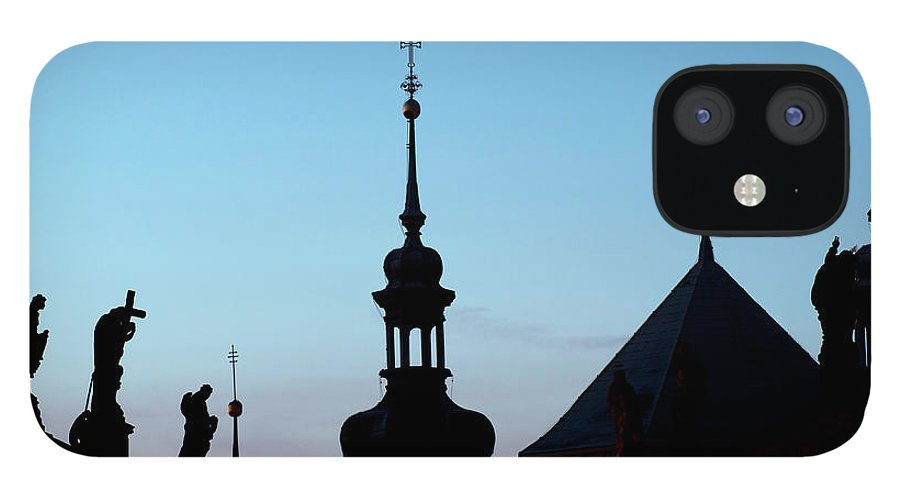 Statue iPhone 12 Case featuring the photograph Statues And Spires In Silhouette, Prague by Shanna Baker